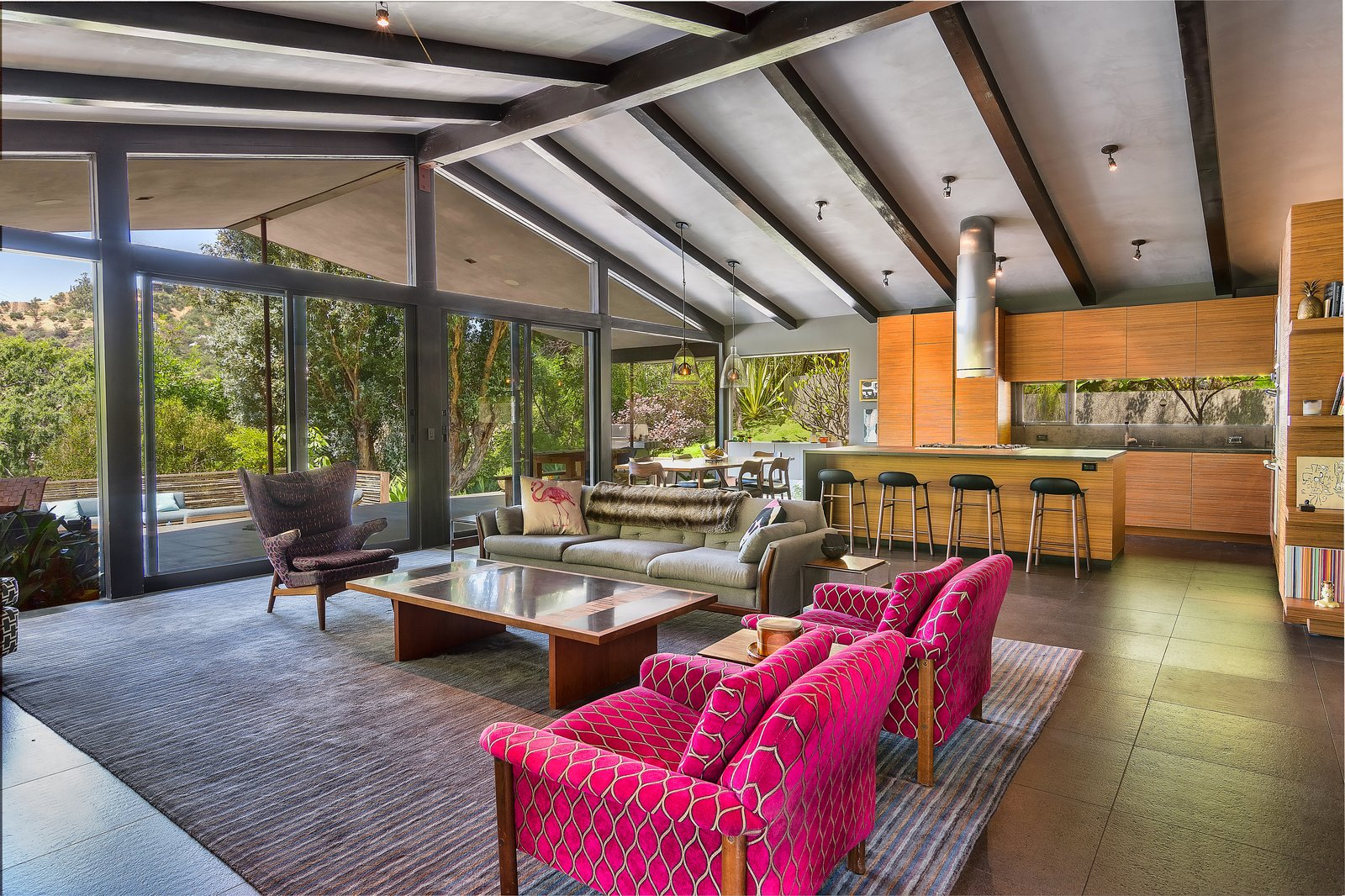 Tagged: Living Room, Chair, Ceiling Lighting, Coffee Tables, Sofa, and Stools.  Photo 3 of 14 in John Legend and Chrissy Teigen's Former Midcentury Home in the Hollywood Hills Is For Sale