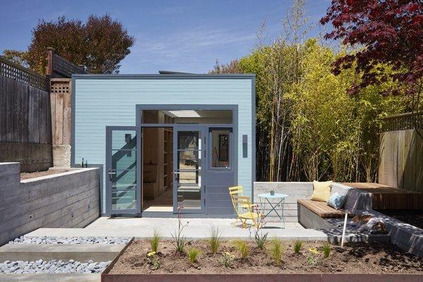 An Unused Garage Is Transformed Into a Light-Filled Backyard Studio