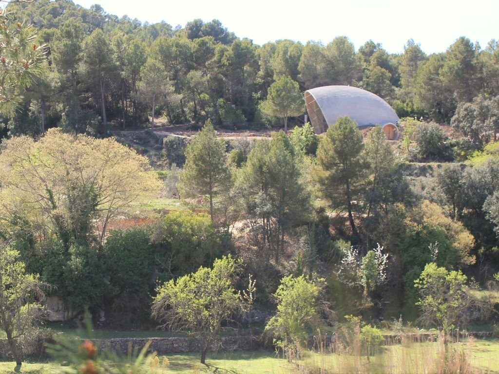 Tagged: Outdoor, Woodland, Trees, Shrubs, and Boulders.  Photo 2 of 8 in Stay in a Domed, Glass-Front Vacation Home in a Spanish Forest