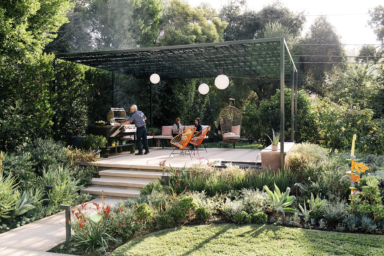 Landscape designer Lillian Montalvo swapped disparate plantings for a cohesive plan centered on a pergola. Tagged: Outdoor.  Photo 4 of 9 in A Laser-Cut Pergola Completes a Tranquil Garden in L.A. That's Perfect For Entertaining