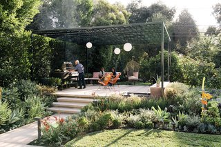 A Laser-Cut Pergola Completes a Tranquil Garden in L.A. That's Perfect For Entertaining - Photo 3 of 8 - Landscape designer Lillian Montalvo swapped disparate plantings for a cohesive plan centered on a pergola.