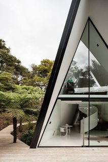 Stay in a Tent-Inspired A-Frame Cabin in the New Zealand Rain Forest - Photo 1 of 7 - The tent-like home responds to the challenging site in a dynamic way.