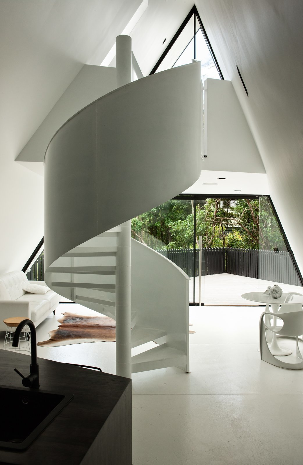 The sharp ridgeline and soaring soffit reference a tent-like experience in an architecturally elegant way. Tagged: Staircase, Metal Railing, and Metal Tread. Stay in a Tent-Inspired A-Frame Cabin in the New Zealand Rain Forest - Photo 4 of 8
