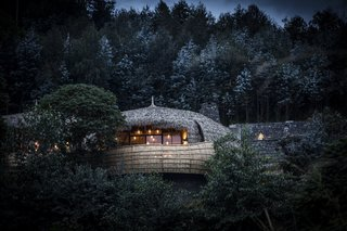 Take an Eco-Escape to a Spherical Forest Villa in an Eroded Volcanic Cone in Rwanda - Photo 1 of 10 - The forest villas were designed by South African architect Nick Plewman.