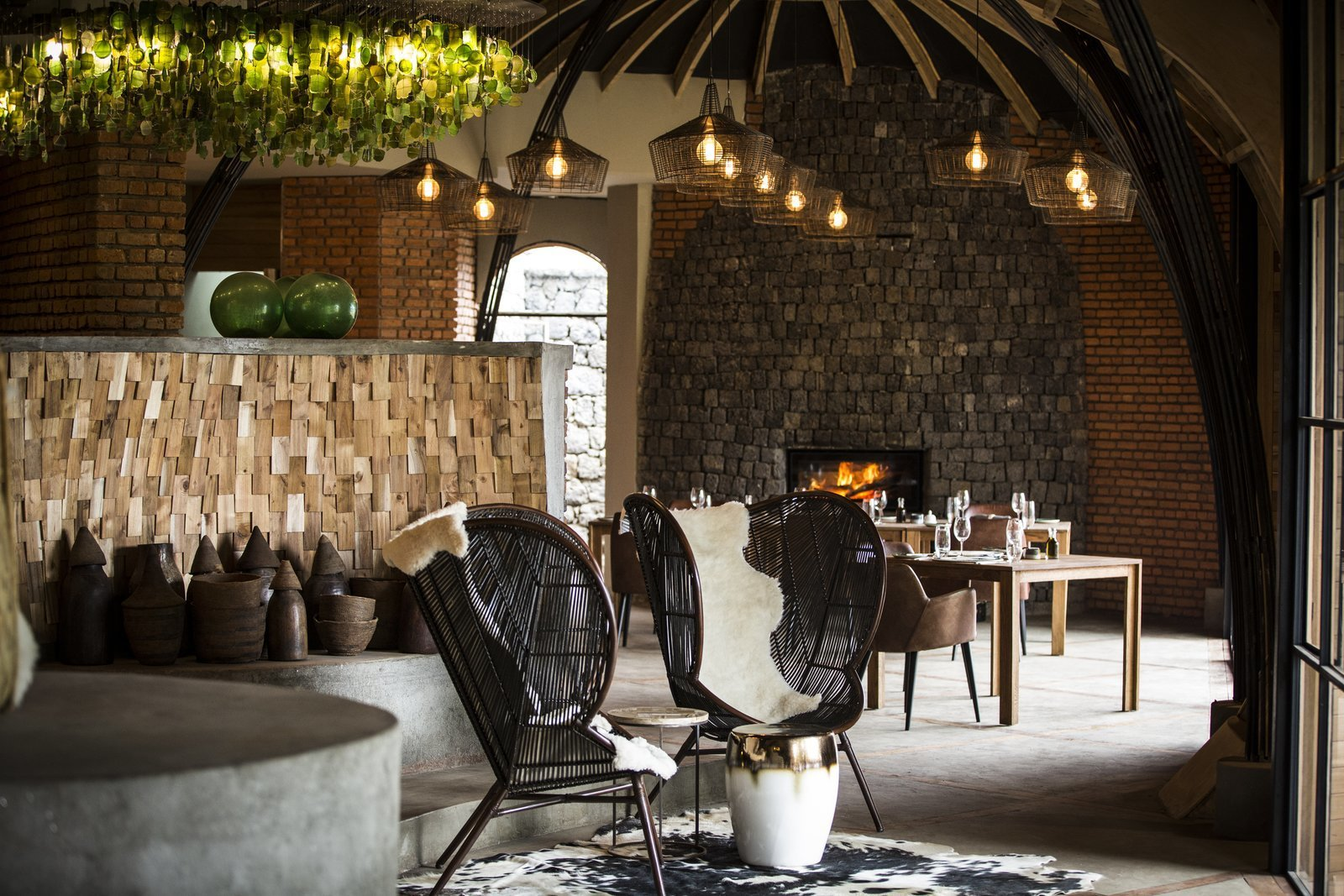 Recycled glass was used for chandeliers and black and white cow hides were used to reflect the rural way of life in the villages.  Photo 7 of 11 in Take an Eco-Escape to a Spherical Forest Villa in an Eroded Volcanic Cone in Rwanda