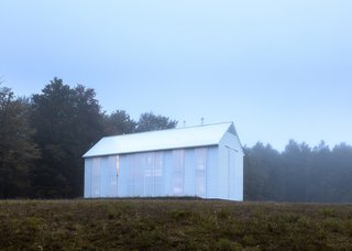 A Louis Kahn-Inspired Barn That's Lined With Floor-to-Ceiling Shutters - Photo 1 of 3 -