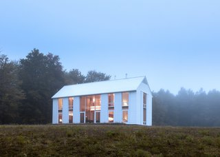 A Louis Kahn-Inspired Barn That's Lined With Floor-to-Ceiling Shutters - Photo 2 of 3 -