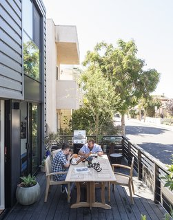 A Family's Cramped Bungalow Is Replaced With an Accessible and Affordable Prefab - Photo 6 of 13 - For the front deck, the couple chose a dining set by Teak Smith; the driftwood and metal corkscrew is by sculptor David Tanych.