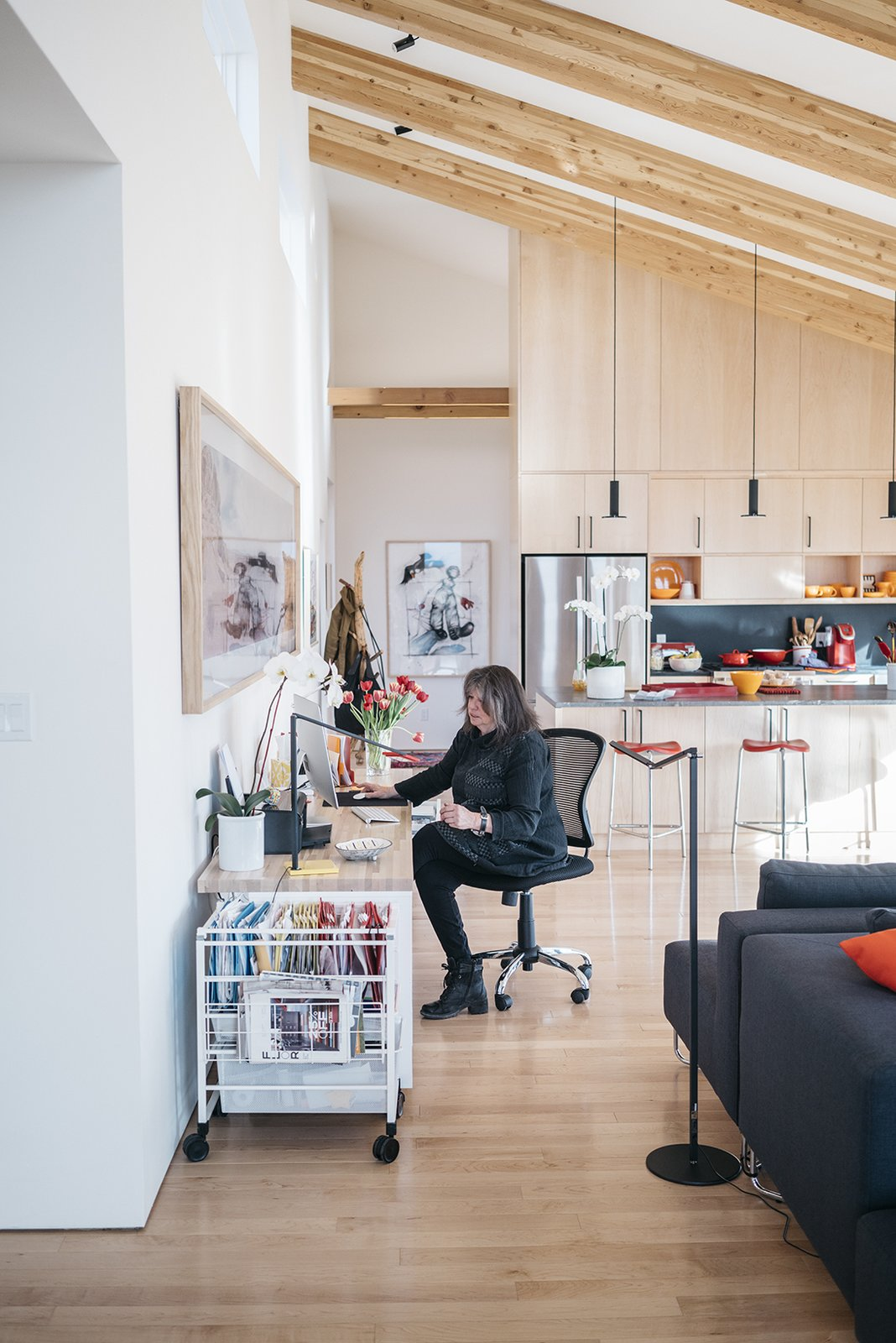 Tagged: Office, Craft Room, Chair, Desk, Storage, Lamps, and Light Hardwood Floor.  Photo 9 of 11 in A Rookie Designer and Her Builder Father Create an Artist's Sculptural Loft in the Desert