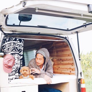 9 Adventure Seekers Who Celebrate Small Space Living Through the Van Life - Photo 2 of 10 - A Japanese couple and their fluffy pooch Roy are traversing the heartland of Japan in their stylish, wood-paneled abode.