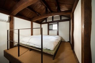 A Minimalist Townhouse Provides Serene Accommodations in Historic Kyoto - Photo 8 of 12 - The second floor bedroom is surrounded by clay walls.  A tatami and futon provide sleeping quarters for two people; a mattress is available, too.