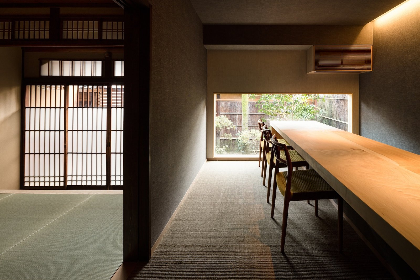 Tagged: Dining Room, Table, Chair, Recessed Lighting, and Carpet Floor.  Photo 10 of 13 in A Minimalist Townhouse Provides Serene Accommodations in Historic Kyoto