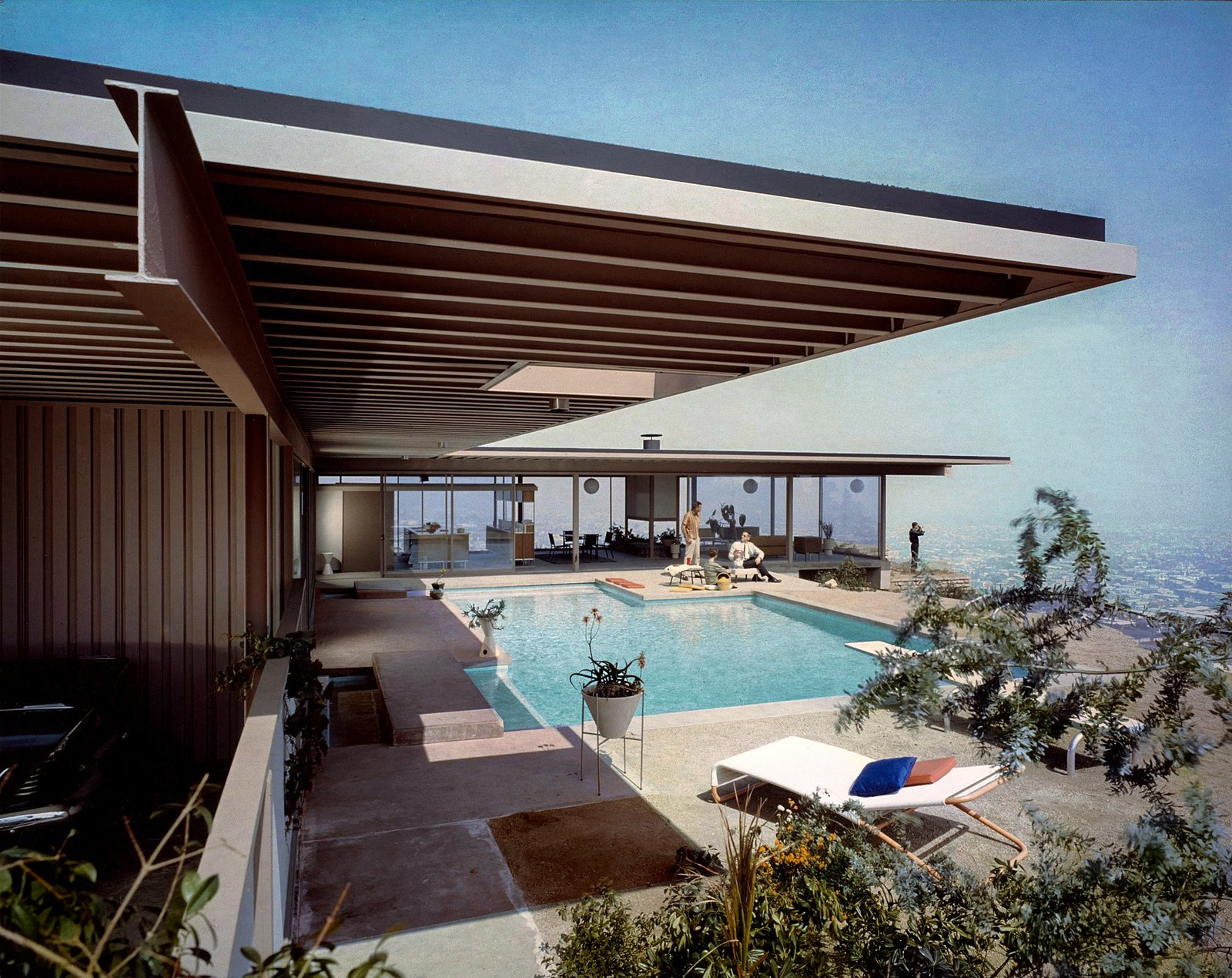From the 1940s through the late 1960s, Arts & Architecture was  the unofficial headquarters of California's nascent modernist movement. It spearheaded the Case Study House Program, which  produced some of America's  greatest residences. VKG furniture was used for many of the houses, and appears in photos shot by Julius Shulman, as seen above. Tagged: Outdoor, Concrete Pools, Tubs, Shower, Back Yard, Large Pools, Tubs, Shower, and Swimming Pools, Tubs, Shower.  Photo 2 of 4 in Spotlight on the Midcentury Design Duo Who Invented the Term Indoor/Outdoor Living