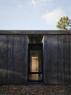 Nature Drove the Design of This Sculptural, Cor-Ten Steel House in Northern California - Photo 6 of 13 - Overlooking the double-height living/dining area is the mezzanine level, where the master suite and office are located.