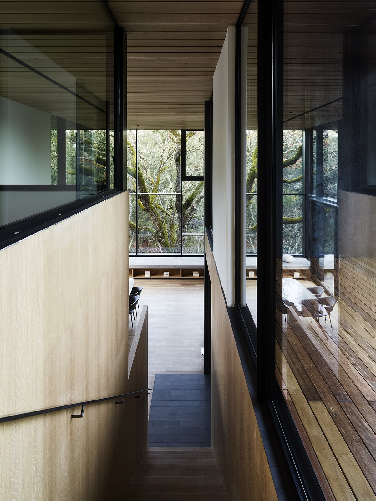 Tagged: Staircase, Metal Railing, and Wood Tread.  Photo 8 of 14 in Nature Drove the Design of This Sculptural, Cor-Ten Steel House in Northern California