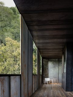 """Nature Drove the Design of This Sculptural, Cor-Ten Steel House in Northern California - Photo 8 of 13 - A second-floor """"pacing"""" deck marks Faulkner's design, as it gives the residents the feeling of being indoors and in the landscape at once. """"The deck runs along the second floor, adjacent to a bedroom,"""" says the architect, who shaded the area with perforated steel screens and more solid Cor-Ten steel."""