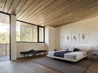 Nature Drove the Design of This Sculptural, Cor-Ten Steel House in Northern California - Photo 9 of 13 - A charcoal triptych by Gina Jacupke hangs above the Living Divani bed in the master suite.