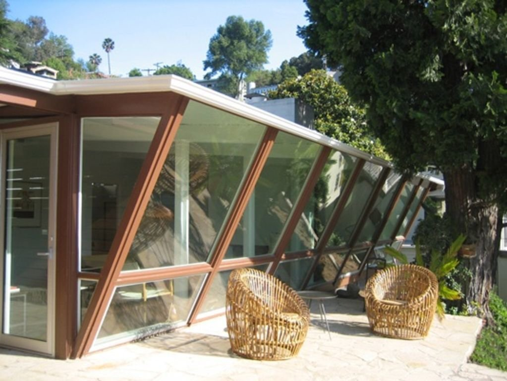 This midcentury-modern home in the Hollywood Hills was recently treated to a renovation. Large windows provide for bright and airy interiors with stunning views, while the large patio is the perfect place to enjoy watching the sunset. To complete your southern California experience, the terraced yard has lemon, grapefruit, and avocado trees.  Photo 11 of 12 in Experience L.A. Like an A-Lister at One of These Modern Short-Term Rentals