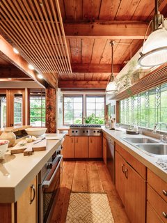 Repurposed Ship Materials and 100-Year-Old Beams Make Up This Tree House-Like Home - Photo 9 of 18 -