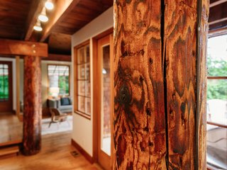 Repurposed Ship Materials and 100-Year-Old Beams Make Up This Tree House-Like Home - Photo 5 of 18 -
