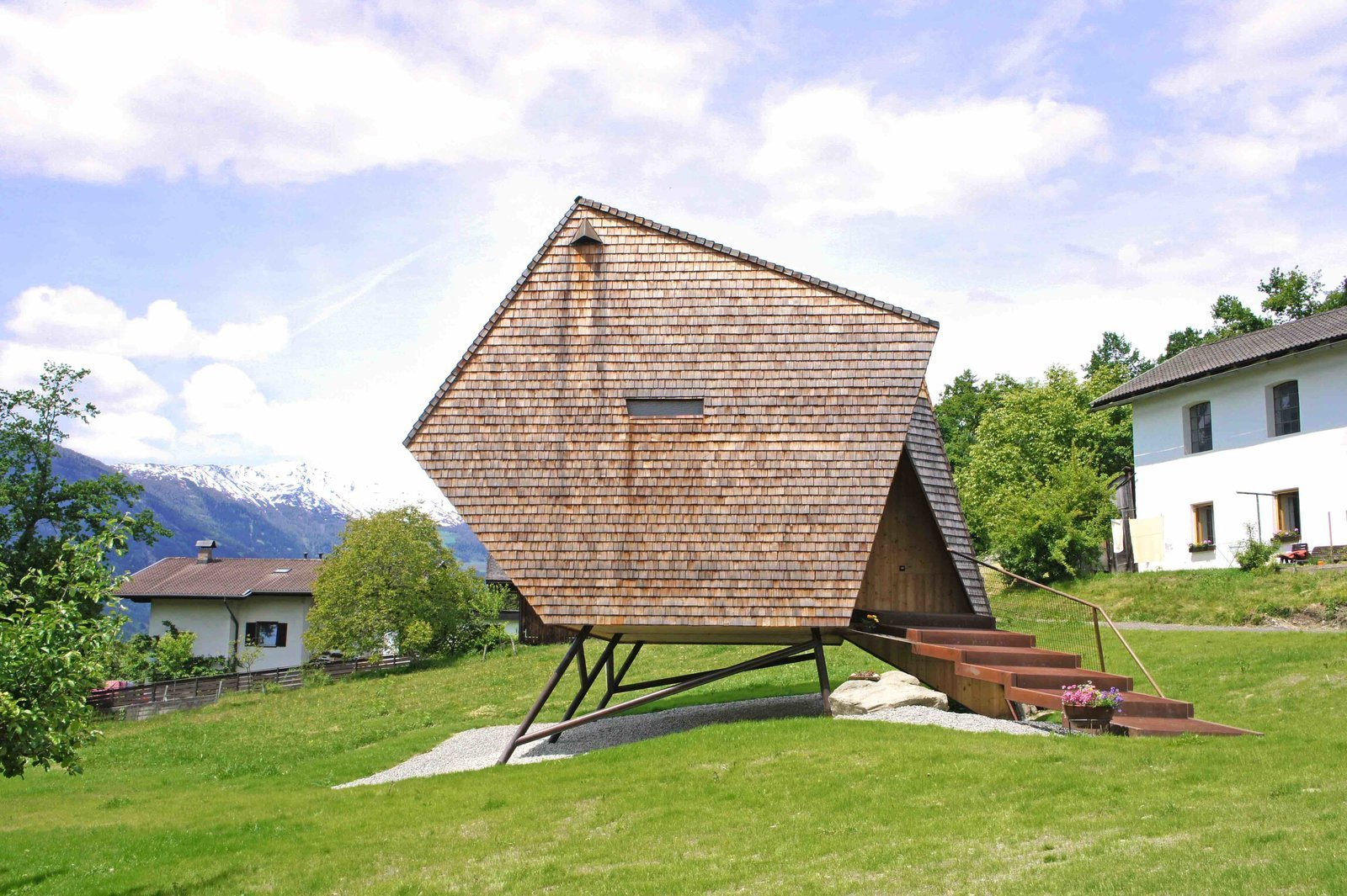 """Because of its irregular, otherworldly form, and how it seems to be suspended in midair, the cabin was named """"Ufogel,"""" which is a melding of the acronym UFO and """"vogel,"""" meaning bird in German."""