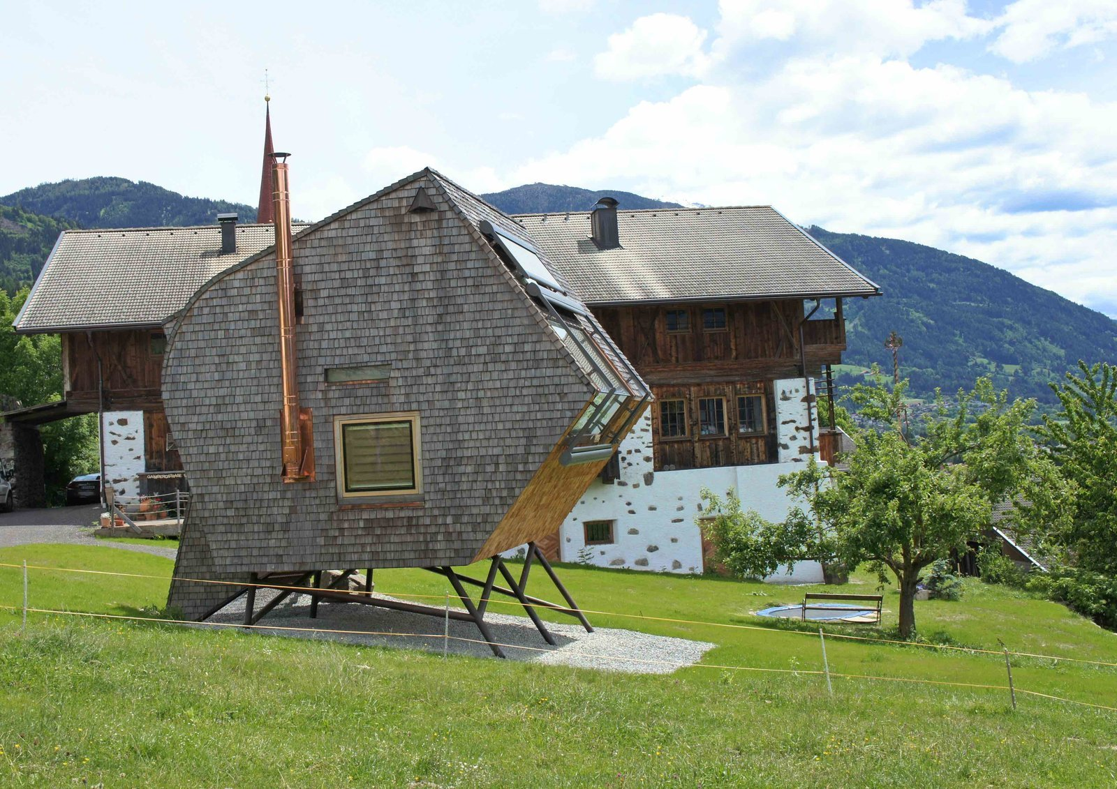 Available for rent through Urlaubsarchitektur, Ufogel's exterior is covered in rustic Austrian-style shingles, but its sharp angles and asymmetrical shape gives it a distinctly futuristic, nest-like look.
