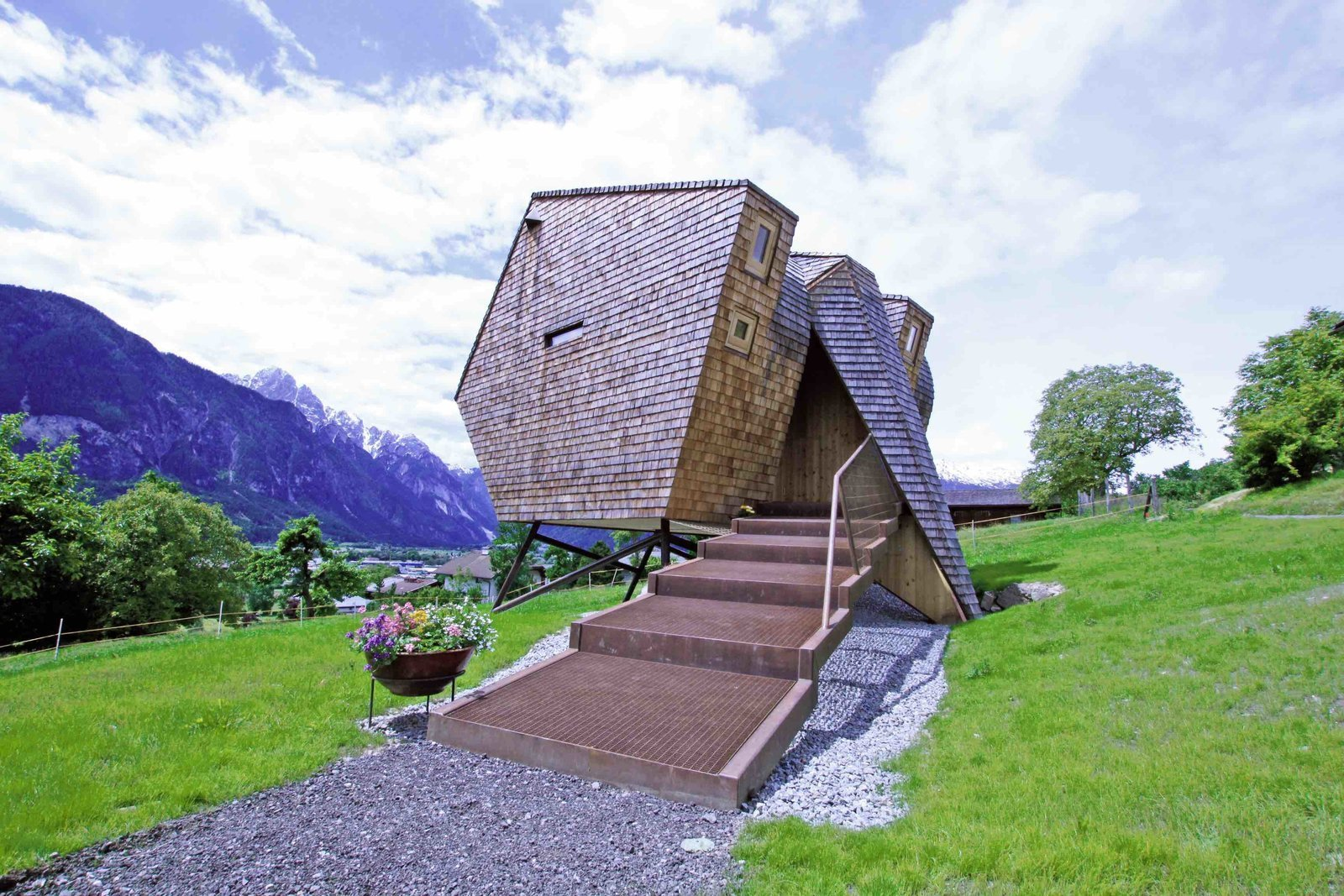 Tagged: Exterior, Shingles Roof Material, House, and Wood Siding Material.  Photo 12 of 12 in Stay in a Tiny Shingled Cabin in Austria That Resembles a Bird-Like UFO