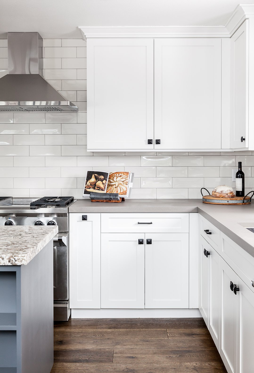 Dwell Magazine : September / October 2017 Tagged: Kitchen, Range, Range Hood, and Subway Tile Backsplashe.  Photo 4 of 6 in In This A-Frame Cabin Makeover, Simplicity Is Key