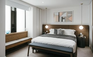 6 Best Dwell UK Apartments - Photo 3 of 7 - In London's Barbican estate, Conran and Partners transformed a 17-story, 1960s British brutalist building with a pick-hammered concrete facade into 74 apartments with ceramic tile, terrazzo, timber floors, and refined brassware.