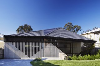An Edgy Slatted Facade Conceals a Striking Indoor/Outdoor Home in Brisbane - Photo 1 of 11 -