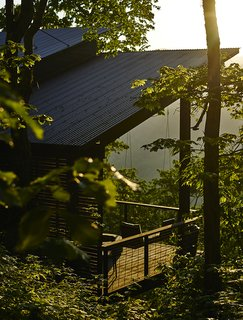 A Rustic-Modern Cabin Inspired by Japanese Bungalows and Shou Sugi Ban - Photo 7 of 12 - The cold-rolled corrugated-steel roofing from B&M Metals will gradually rust, achieving a weathered look.