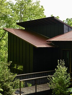 "8 Japanese-Inspired Spaces We Love - Photo 2 of 8 - Referring to the design aesthetic as ""Japanese rustic modern,"" this 1,000-square-foot summer home in Asheville, Georgia, by ASD/Sky was inspired by wooden bungalows they saw during a trip to Kyoto, Japan. The exterior's stained-pine boards were intended to mimic the look of traditional shou sugi ban, where the outer layer of wood is charred to protect it from rot and fire."