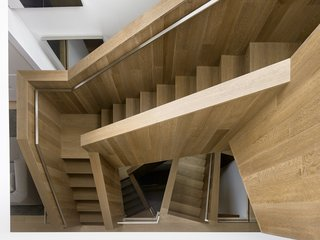 A Historic Victorian in San Francisco Is Meticulously Transformed Into a Modern Family Home - Photo 11 of 26 - The stairs are made of fumed and stained, engineered oak with a solid oak cap. Thanks to its complex geometry, no level is the same.