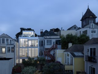 A Historic Victorian in San Francisco Is Meticulously Transformed Into a Modern Family Home - Photo 8 of 26 - The rear facade is illuminated at night.