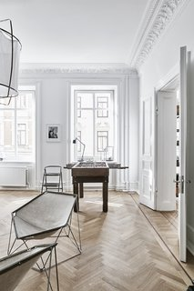 A Careful Renovation of a 19th-Century Flat in Gothenburg Brings it Back to Life - Photo 5 of 11 - The Penta chairs are by Kim Moltzer and Jean-Paul Barray.
