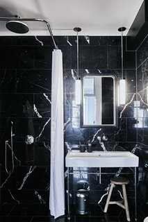 A Careful Renovation of a 19th-Century Flat in Gothenburg Brings it Back to Life - Photo 9 of 11 - The bathroom is clad in black marble sourced from Spain.