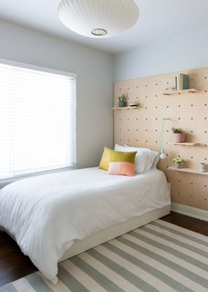 Feel at Home While Exploring Austin at One of These Modern Short-Term Rentals - Photo 3 of 17 - The second bedroom has a trundle twin bed and is finished with a quirky wooden wall treatment.