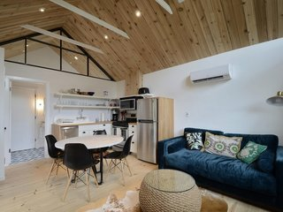 Feel at Home While Exploring Austin at One of These Modern Short-Term Rentals - Photo 4 of 17 - This 450-square-foot studio sleeps two people and features tall, exposed-wood ceilings with an A-shaped clerestory window that floods the interior with light.