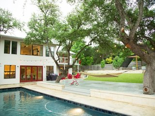 Feel at Home While Exploring Austin at One of These Modern Short-Term Rentals - Photo 10 of 17 - This 3,800-square-foot home boasts a warm contemporary design. With five bedrooms, a full-sized pool, fire pit, tree house, and trampoline, it's perfect for a big group traveling together or a pair of families with kids.