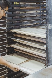 "Go Behind the Scenes With a Process-Driven Handmade-Tile Company in California - Photo 9 of 13 - Drying:  Damp tiles go in an industrial dryer for about 12 hours to remove excess moisture before their first firing at nearly 2,000 degrees. Once fired, tile is called ""bisque."""