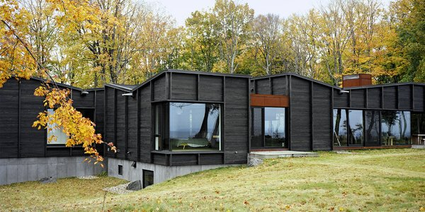 Plagued Ash Trees Were Repurposed to Create This Charred-Cedar Clad Home on Lake Michigan
