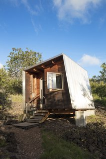 "Two Tiny Pavilions Respectfully Perch Atop a Lava Flow on Maui - Photo 1 of 8 - Clad in western red cedar, a studio called Mauka, Hawaiian for ""inland toward the mountains,"" anchors a getaway in Maui that architect Erin Moore designed to honor the owner's connection to the land.<br>"