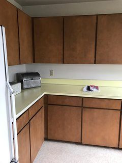 A Family-Run Operation Refreshes a Portland Midcentury, Now Offered at $899K - Photo 9 of 13 - Before: Kitchen