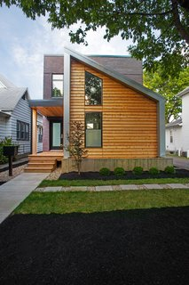 Clad in Cedar and Metal, an Indianapolis Home Gives a Modern Salute to its Traditional Surroundings - Photo 1 of 11 -