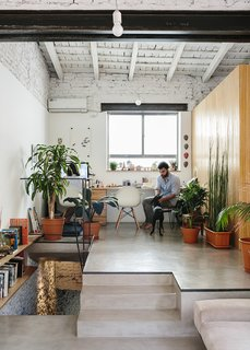 An Architect Turns His Small, Dark Apartment in Buenos Aires Into a Bright and Airy Home - Photo 2 of 10 - Architect Hernán Landolfo and his girlfriend, photographer Lucia Gentile, live and work in the apartment, sharing an elevated office space.