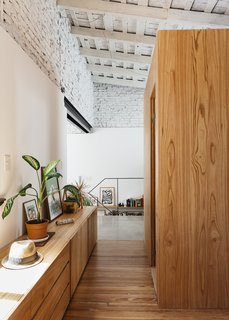 An Architect Turns His Small, Dark Apartment in Buenos Aires Into a Bright and Airy Home - Photo 9 of 10 - A wood floor uncovered during demolition delineates the private quarters.