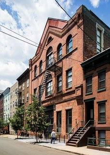 A 19th-Century Carriage House Is Transformed Into a Live/Work Residence For a Pair of Artists - Photo 3 of 5 -