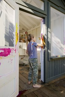 Space and Storage Needs Guide the Expansion of a Family's Cottage North of San Francisco - Photo 6 of 12 - Leo repaints his playhouse in a color that's more to his liking.
