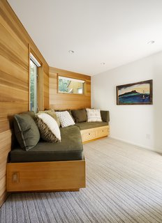 Space and Storage Needs Guide the Expansion of a Family's Cottage North of San Francisco - Photo 9 of 12 - The custom bench in the media room was designed and built by Henrybuilt.