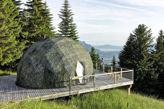 Go Eco-Friendly Glamping in These Geodesic Domes in the Swiss Alps - Photo 1 of 10 - The color of the pods is adapted to fit each season: white in the winter and green in summer.